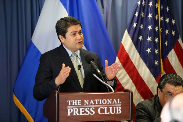 President of Honduras Juan Orlando Hernandez listens to questions from reporters on June 17, 2015 in Washington, DC