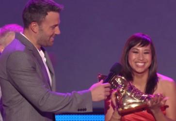 Ben Affleck presents Boston University Student Katia Gomez with $100,000 for Honduras Education